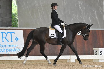 Samantha Bray rode 'Merricks Finesse' to score 78% in round one of the Four Year Old Young Dressage Horse class...