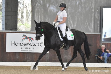 Successful  Victorian dressage rider, Justine Greer rode , 'Revelwood Stedfast' to score 79.02% for fifth place in round one of the Four Year Old Young Dressage Horse class.