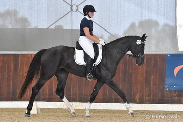 Louise Robertson is pictured aboard , 'Bellaire Cartier' during round one of the Four Year Old Young Dressage Horse class.