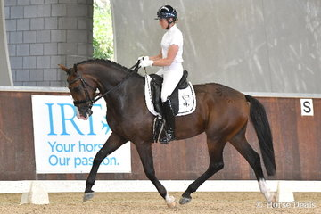 Well known professional international rider, Maree Tomkinson rode the Tomkinson Group's latest Diamantina production, 'Neo' to earn 87.80% for third place in round one of the Four Year Old Young Dressage Horse class.