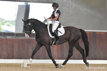 Kristy-Lee Brilliant is pitured aboard, 'Carrerai' during  round one of the Four Year Old Young Dressage Horse class.