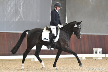 Very well known in the equestrian world, the popular Jason James rode, 'Total Zensation' to earn 70.60% in round one of the Four Year Old Young Dressage Horse class.