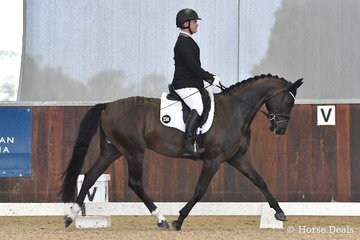 Jack Palfryman rode , 'Ellanbrae Jupiter' to score a good, 70.80% in round one of the Four Year Old Young Dressage Horse class.