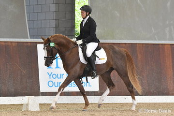 Carol Ross riding 'Fawks Picture Perfect' placed third in the 4yo Young Pony Round One.