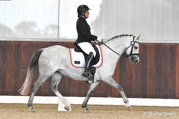 Bettina Kopetzky riding 'The Silver Rose' won the 6 yo Young Pony Round One.