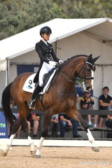 Jemma Heran from Queensland rode her imported, 'Hedelunds Mefisto' to win the FEI CDN Under 25 Grand Prix.