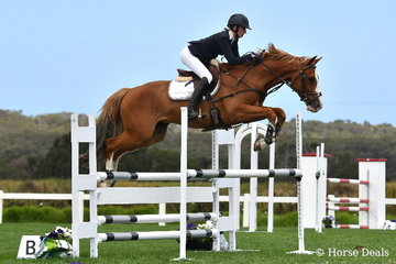 Tori Stuckey had a busy day rushing from the dressage arena to the showjumping ring. She is pictured aboard, 'Jaybee Ballon D'Or' that jumped clear in the first round of the 1.10m class this morning.