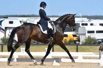 Maree Tomkinson made an impressive debut in to Grand Prix competition with her beautiful, imported eight year old mare, 'Donna Elena' by winning the Browns Sawdust FEI CDN Grand Prix with 67.37%.