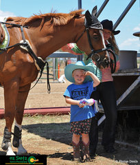 4 year old, Indy Andrews was at the Australia Day Showjumping on the weekend watching her cousin. Indy has been riding for 1 year now and hopes to barrel race in the near future. She is pictured here with her Cousin Charleigh Andrews and her Horse Bully a 6 year old throughbred.