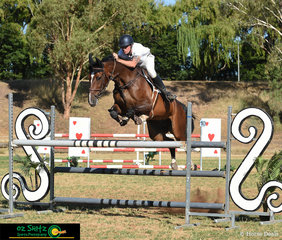 Out of World Cup mare, Alice, Hayden James rides James' Carrera in the 1.20m Championships on the final day of the Australia Day Show Jumping Championships.