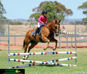 8 year old, Georgina Roberts competes her 12 year old pony, Sparky in the 70cm at the Australia Day Show Jumping at Toowoomba.