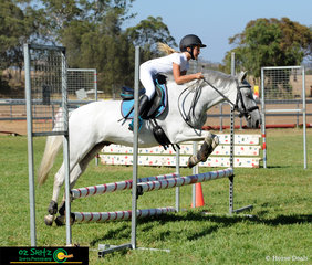 Isabella Forsyth riding Ethereal Star Wrangler soar over the second part of the combination in the Under 14 70cm AM5.