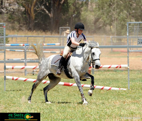 Beau Lyttle and He's Pablo race towards the finish flags in the 80cm Pairs Jigsaw competition at the Australia Day Show Jumping Championships.