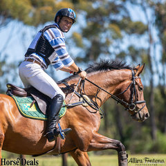 Shane Rose always has time for a smile and wave, even during his cross country round aboard Stakkino.