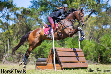 Emily Hill riding Gosh easily sail over the seat jump mid-way through the cross country course.