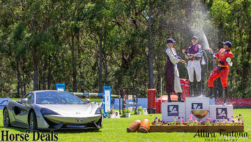 Winners of the Eventers vs Showjumpers next to the McLaren car, worth over $500.000!