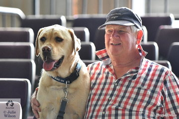 Knowledgeable horseman, Bruce Redpath keeps an eye on proceedings at the Victorian ASH State Championships conducted at the Elmore Equestrian Park, accompanied by his best mate, 'Stanley'.