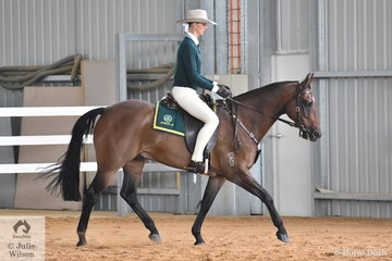 Tia Andrews won the ASHLA class with her, 'Waymere Oaks Enterprise'.