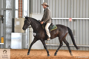 """Andrew Walker is pictured aboard Kim McCallum's, 'Viewhill Solar"""" during the Stephens Pasture Seeds Four Year Old Maturity."""