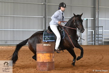 Sally Beer is pictured aboard her, 'Braeview Oaks Ledger' during the Time Trial Section of the Open Challenge.