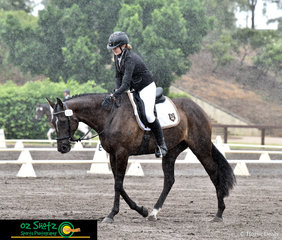 Despite the rain making a heavy appearence during their test, Shai Dever and Wildfires Illusion prove to beat the odds and end up in first place after the dressage in the EvA95C Junior.
