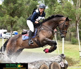 Current NEGS student, Anna Jarvis and Joleka Leome make a splash as they exit the EvA95 water complex at the Sydney Eventing Summer Classic.