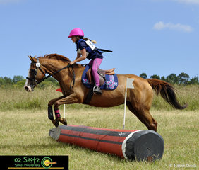 Pretty in pink was Clare Vandewater on her pony Meg in the EvA60D Junior at Sydney Eventing Summer Classic.