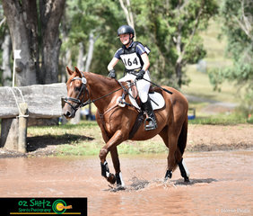 Smiles all round as proud rider, Abby Spencer praises her horse, Murphy for conquering the water complex at the Sydney Eventing Summer Classic.