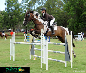 Jellystone Park Manhatten takes rider Demi Rowlandson over the final fence in the CCN2* showjumping phase.