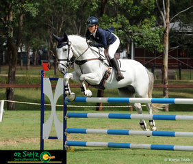 Soaring over the second fence in the combination Junior rider Charlotte Lalak and Topper II have their concentration faces on during the Show Jumping phase of the CCN2 Star class.
