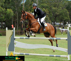 Looking towards the finish flags, Andrew Barnett and Go Tosca come through the final combination of the CCN2 Star Show Jumping phase of the Sydney Eventing Summer Classic.