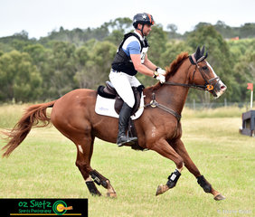 Cantering off after the Rustic Hut in the CCN3 Star cross country was Shaun Dillon on Another Biscuit at the Sydney Eventing Summer CLassic.