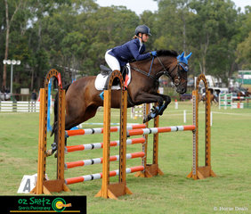 With a clear round with 59 seconds, Woody Would If He Could and Gemma Silk show great form over each fence in the CCN1 Star show jumping phase of the Sydney Eventing Summer Classic.