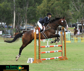 Asellus and Amelia Brydon have no trouble clearing the fences in the EvA95 show jumping at the Sydney Eventing Summer Classic.