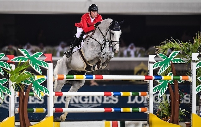 Sven Schlüsselburg and his grey gelding Bud Spencer picked up just a single time fault in both rounds to help Team Germany to victory at today's Longines FEI Jumping Nations Cup™ of the United Arab Emirates in Abu Dhabi (UAE). (FEI/Martin Dokoupil)