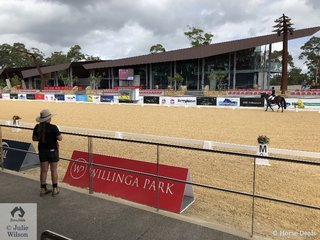 The wonderful outdoor ebb and flow dressage arena at Willinga Park was used for the Grand Prix horses last week. This week the GP moves indoors and the younger horses are outside. The VIP area is pictured beyond the arena.