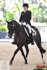 Successful dressage rider, equine scientist and former international dressage Chief d' Equipe, Elizabeth Owens is pictured aboard her Australian bred, 'Revelwood Starlite' during the Netier Prix St Georges CDN.