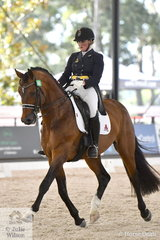 Successful Queensland Grand Prix rider, Sheridan Ashwood rode her home bred, 'Ashwood's Chocolate Fondu' to take fifth place in the Netier Prix St Georges CDN with 68.67%.