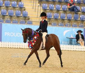"""Champion Medium Child's Pony """"Braeburn Park Spring Dance"""" ridden by Tia McKenzie."""