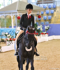 "Alexandra Berle riding ""Karma Park Royal Silk"" in the Child's Small Hack of the Year event."