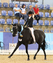 """Olivia Daffurn rode """"Taittinger"""" to claim Runner Up in the Child's Large Hack of the Year event."""