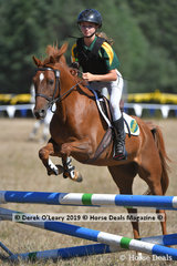 "Leonora Turner riding ""Marshall Artz"" in the D Grade Championship"
