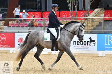 Deon Stokes rode Lisa Carver's Andalusian stallion, 'Regalo De Susaeta' by Dobion to third place in Round 2 of the 5 Year Old Young Dressage Horse class.