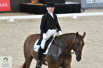 Paula Price from Queensland looks pleased with her, 'True Sensation' by Fire Oak xx that took second place in the Grand Prix Freestyle CDN.