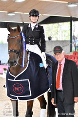 Grand Prix Freestyle CDI 4* winners, Mary Warren and, 'Mindarah Park Raphael' are pictured with the master of Willinga Park, Terry Snow.