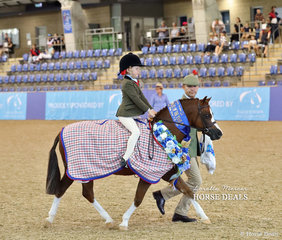 """Champion Hunter Lead Rein Pony """"Armanii Park Robin Hood"""" ridden by Sophie Towers and led by Michael Gates. Earlier in the day the pony was declared Champion Small Hunter Pony of the Year."""