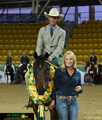 Kim Dent from Baxter Boots, sponsors of the Futurity, presents the garland and rug to overall winner Adam Wallen and Doongara Power Wishes.