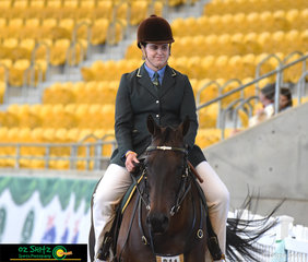 Making their way to present to Heath Andrews for their workout in the Working Gelding 5 Years and Over is Alysia Gardner riding Coolidowns In Time