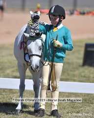 Cooper Owen from Riddells Creek with Wyann Camelot in the 8yo and Under Handler Class
