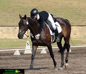 Over-joyed with their performance in the dressage phase of the EvA95 Eventing at the NSW Interschool State Championships, Nina Hillier hugs Statford Noah after a very impressive test.